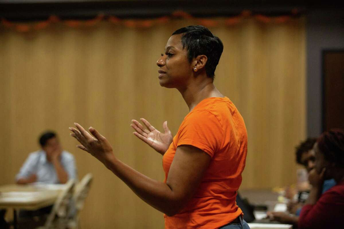 Renee Jefferson-Smith defends her lawsuit against District B candidate Cynthia Bailey at a general meeting at Acres Homes Multi Service Center.