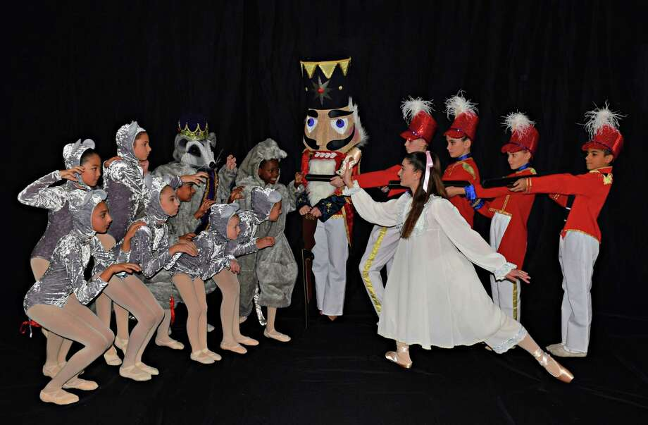The Nutcracker battle scene features, from left, Makayla Tansuriwongse, Westport; Phoebe Nunziato, Westport; Felix Baer (Rat King), Westport; Simran Soin, Wilton; Olivia Kross and London Morris, Norwalk; Skyie Augustin, Fairfield; Hazel Samardzija, Norwalk; Lily Wilcox, Norwalk; Lilliana Sperry (Clara) Weston; Lindsay Gare, Weston; Anna Coughlin, Wilton; Natalia Mann, Westport; Elijah Schlegel, Norwalk; and special guest Emily Bivona. Photo: Lar J / Connecticut Theater Dance / Wilton Bulletin Contributed