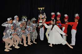 The Nutcracker battle scene features, from left, Makayla Tansuriwongse, Westport; Phoebe Nunziato, Westport; Felix Baer (Rat King), Westport; Simran Soin, Wilton; Olivia Kross and London Morris, Norwalk; Skyie Augustin, Fairfield; Hazel Samardzija, Norwalk; Lily Wilcox, Norwalk; Lilliana Sperry (Clara) Weston; Lindsay Gare, Weston; Anna Coughlin, Wilton; Natalia Mann, Westport; Elijah Schlegel, Norwalk; and special guest Emily Bivona.