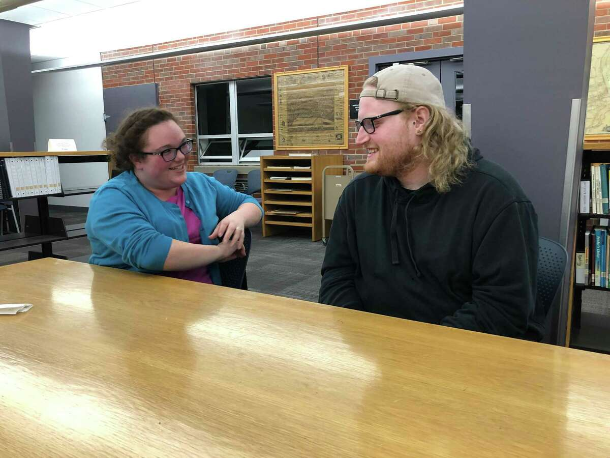 Valerie Lepoutre, of Middletown, and Collin Schuster, of Old Saybrook, share a laugh at a recent mental health support group session at the Russell Library in Middletown. The group, led by Lepoutre, is for those ages 18 to 29 who have experienced symptoms of a mental health condition. Lepoutre is the young adult coordinator for National Alliance on Mental Illness Connecticut.