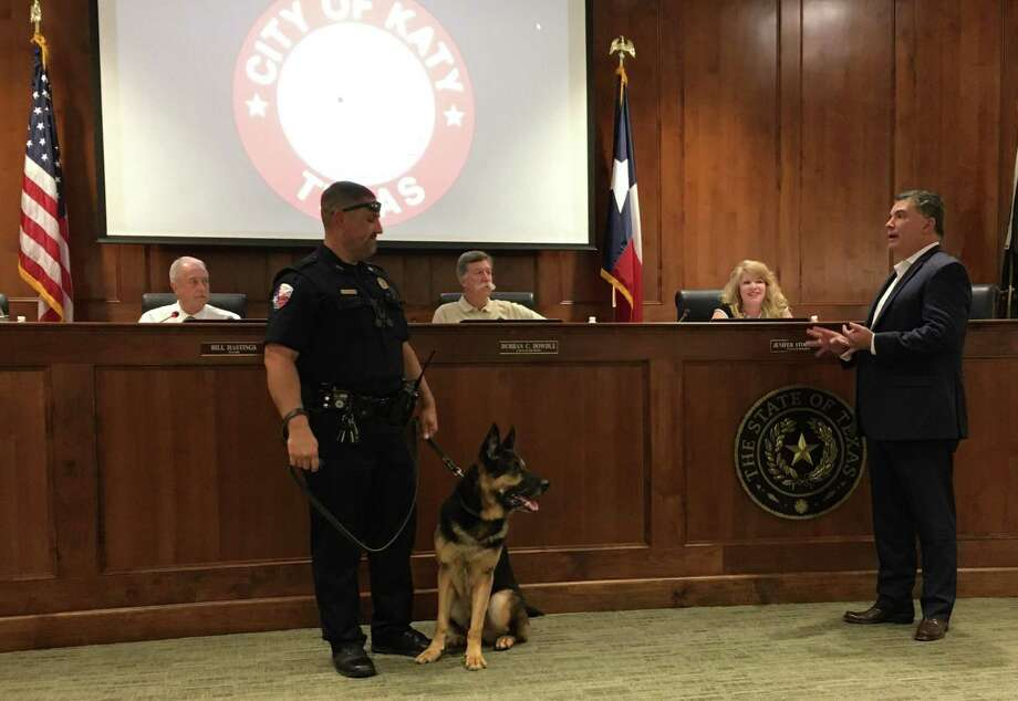 Katy Police Chief J. Noe Diaz, at right, introduced the Katy Police Department's newest canine officer at the Nov. 21 Katy City Council. Two-year-old Kiko is a bomb detection dog donated by K9s4COPS. With him is his handler Officer Steve Kelleher. Photo: Karen Zurawski / Karen Zurawski