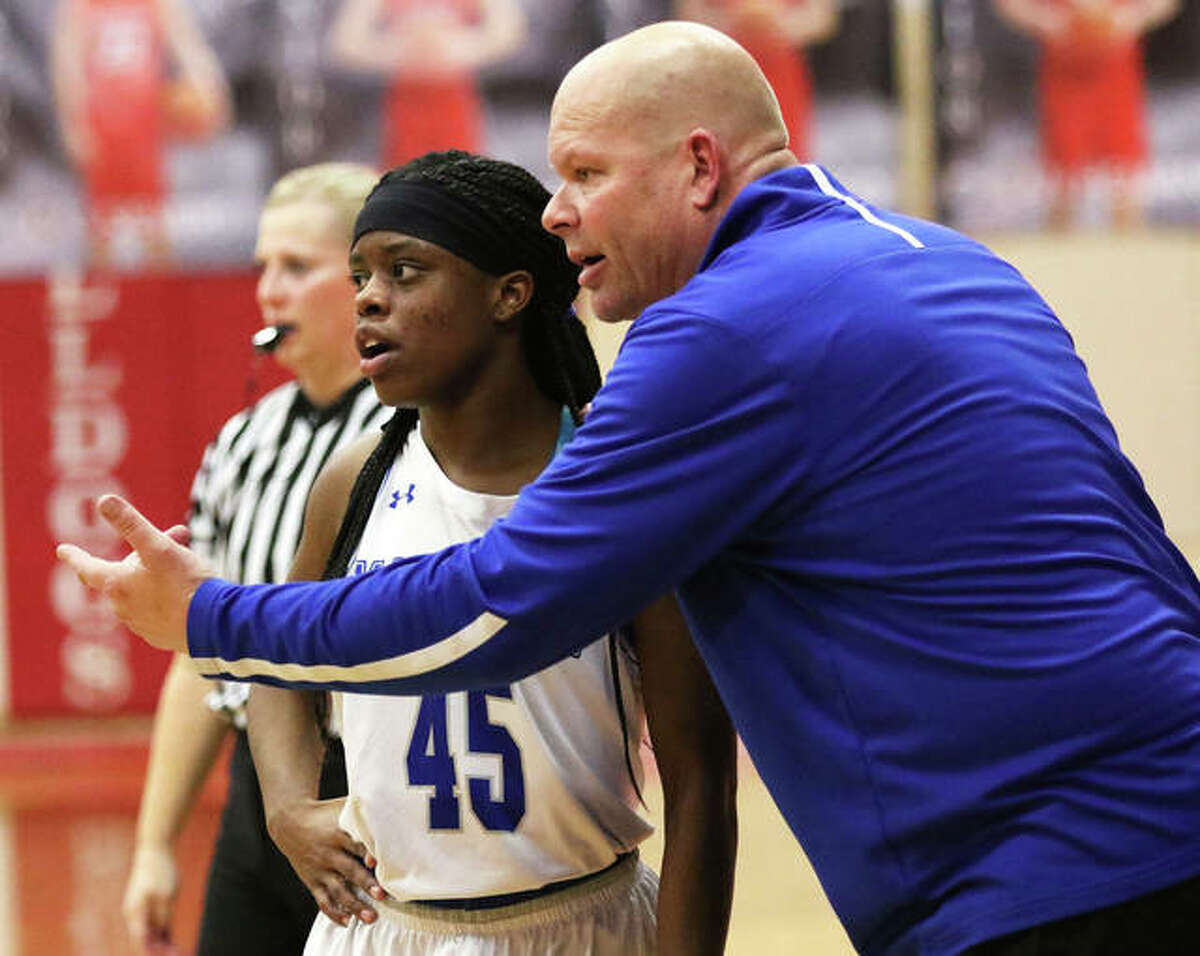 Marquette Catholic coach Lee Green (left) talks instructs the Explorers' Adrenna Snipes during a Class 2A regional semifinal last season at Staunton. On Thursday night, Snipes' shot at the buzzer gave Marquette a win over Greenville in the Columbia Tournament.