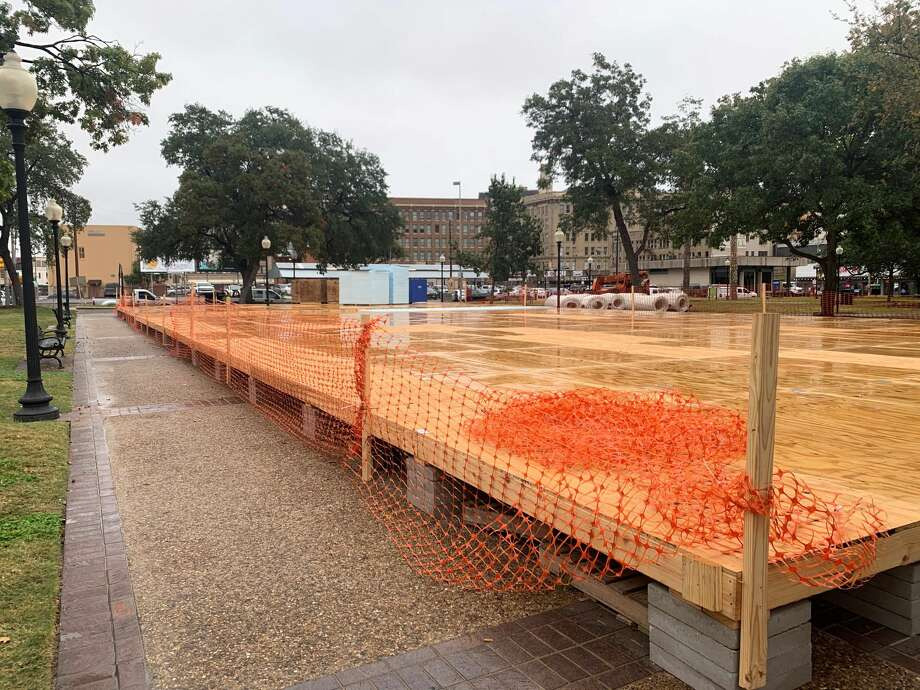 The ice rink at Travis Park is on pace to open by Friday, Nov. 29 during the tree lighting ceremony at the downtown park, according to officials. The photo shows the construction of the rink on Friday. Photo: Priscilla Aguirre