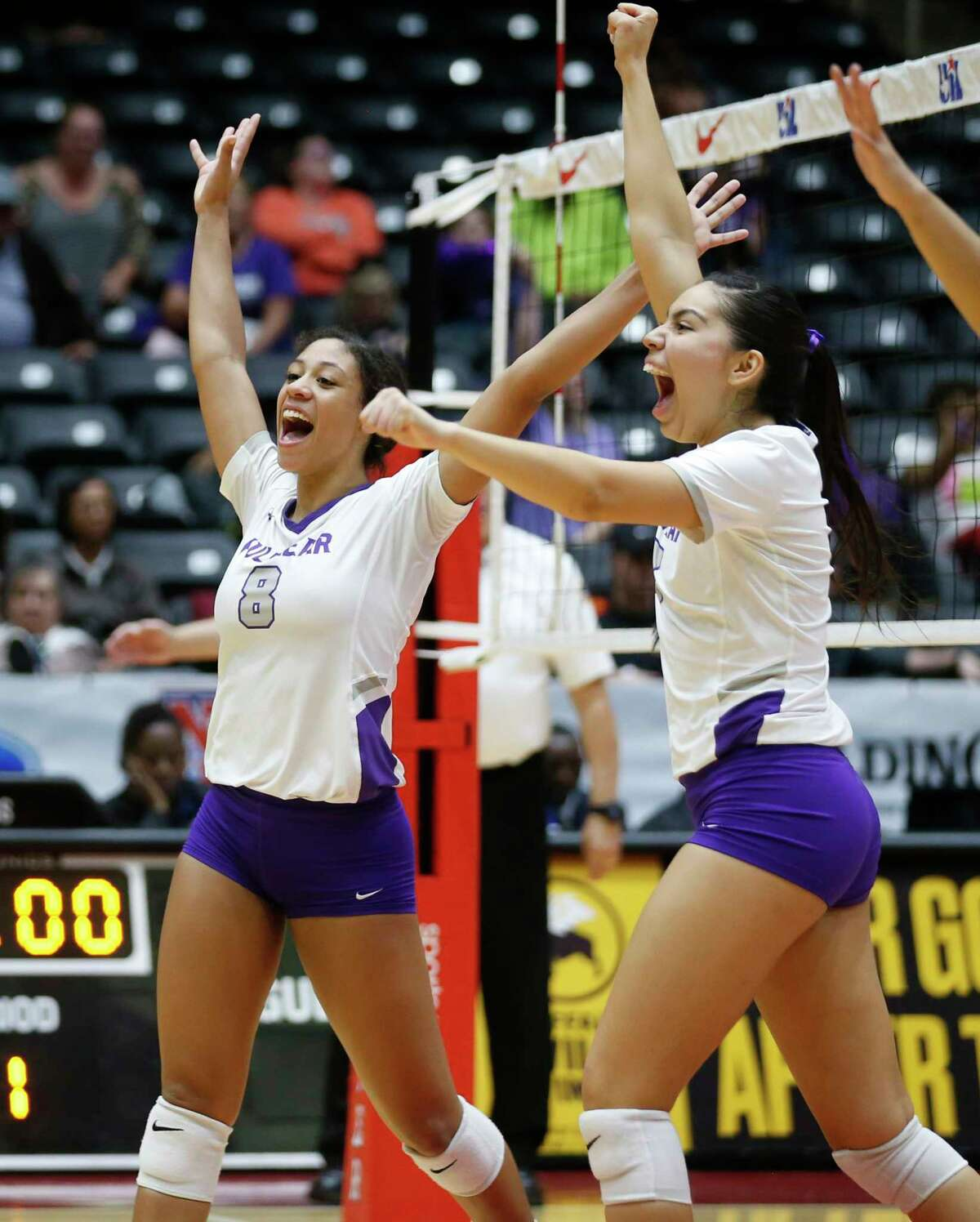 Lamar Fulshear?•s Alexis Dacosta (8) and Jalile Rodriguez (17) celebrate after gaining a point in the third and final set of a Class 4A volleyball state semifinal match against Kennedale at the Curtis Culwell Center in Garland, on Thursday, November 21, 2019. Fulshear won three straight sets 25-14, 25-11 and 25-20 to advance to the state final.