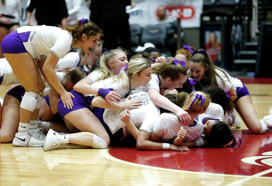 The Lamar Fulshear Chargers dog pile after winning a Class 4A volleyball state semifinal match against Kennedale at the Curtis Culwell Center in Garland, on Thursday, November 21, 2019. Fulshear won three straight sets 25-14, 25-11 and 25-20 to advance to the state final. Photo: Juan Figueroa, Staff Photographer / © 2019 Juan Figueroa / The Dallas Morning News