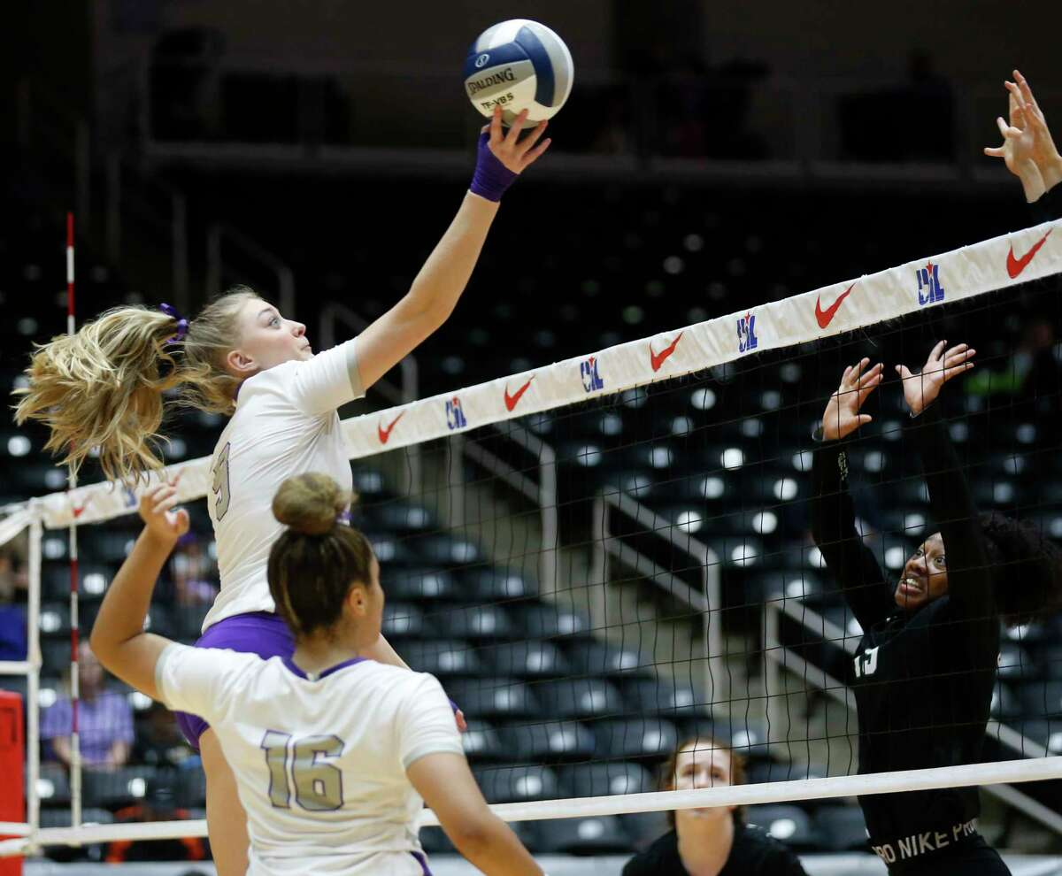 Lamar Fulshear?•s Skylar Voskuhl (9) hits the ball over Kennedale?•s Alexandra Youngblood (15) during the third set of a Class 4A volleyball state semifinal match at the Curtis Culwell Center in Garland, on Thursday, November 21, 2019. Fulshear won three straight sets 25-14, 25-11 and 25-20 to advance to the state final.