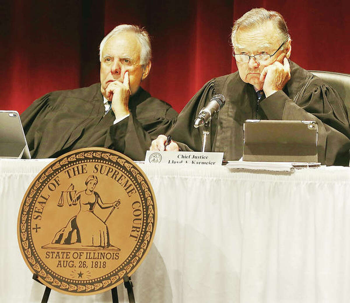 Illinois Supreme Court Chief Justice Lloyd A. Karmeier, right, and Justice Robert R. Thomas, left, listen to oral arguments Sept. 18 in one of two cases before the court during a traveling session held at Hatheway Hall on the campus of Lewis and Clark Community College in Godfrey. Two cases were argued before the court before more than 700 students, politicians, and local attorneys. A question and answer session was held for the parties involved after the court adjourned.