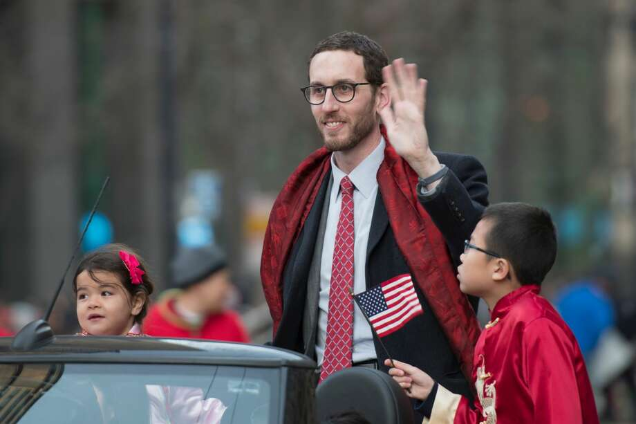 California State Senator Scott Wiener waves to the crowds on Market Street in San Francisco during the Chinese New Year Parade on February 24, 2018. Photo: Getty Images