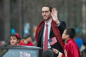 California State Senator Scott Wiener waves to the crowds on Market Street in San Francisco during the Chinese New Year Parade on February 24, 2018.