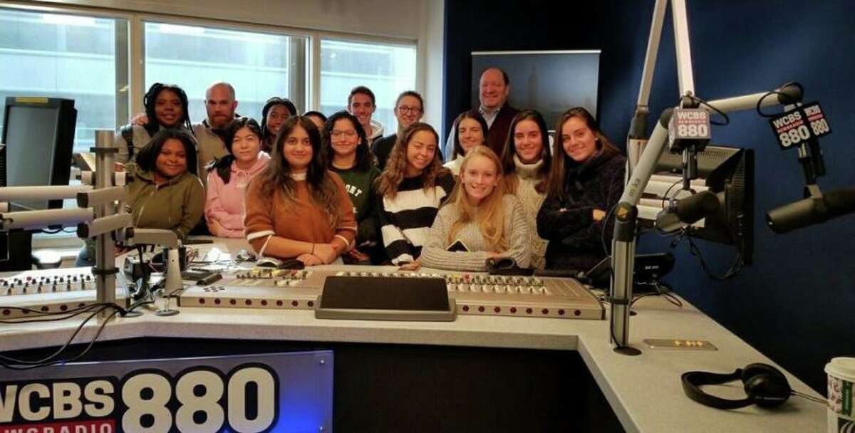 """The staff of the Stamford High School newspaper, """"The Round Table,"""" pose inside the CBS radio station building in New York City on Nov. 13."""
