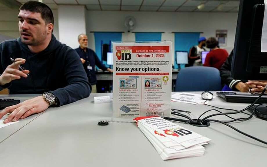 Information about the Real ID requirements is posted at the Secretary of State's driver's license facility in the James R. Thompson Center in Chicago, Ill. on Wednesday, March 27, 2019. (Brian Cassella/Chicago Tribune/TNS) / Chicago Tribune