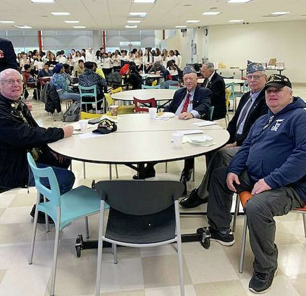Veterans Alan Sosnowitz, left, Cortland Mehl, Jim Dudley and Peter Mason attend the the Academy of Information Technology & Engineering's 12th annual Veterans Day Breakfast on Nov. 7, 2019 in Stamford, Conn.