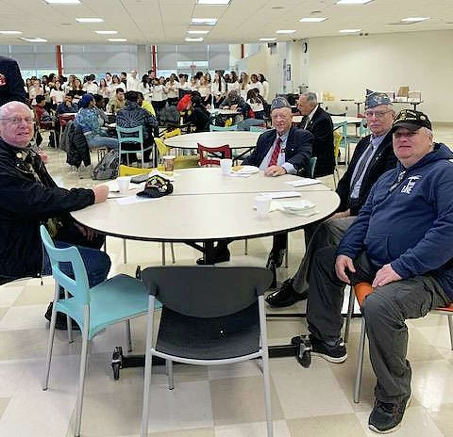 Veterans Alan Sosnowitz, left, Cortland Mehl, Jim Dudley and Peter Mason attend the the Academy of Information Technology & Engineering's 12th annual Veterans Day Breakfast on Nov. 7, 2019 in Stamford, Conn. Photo: Teaetta DeSuzia / Contributed Photo / Stamford Advocate contributed