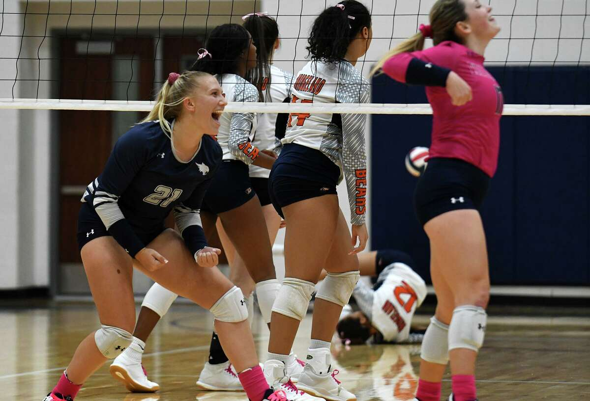 Tomball Memorial junior outside hitter Lorelai Stramrood (21) celebrates a point against Bridgeland during the fourth set of their District 14-6A matchup at Bridgeland High School on Oct. 15, 2019.