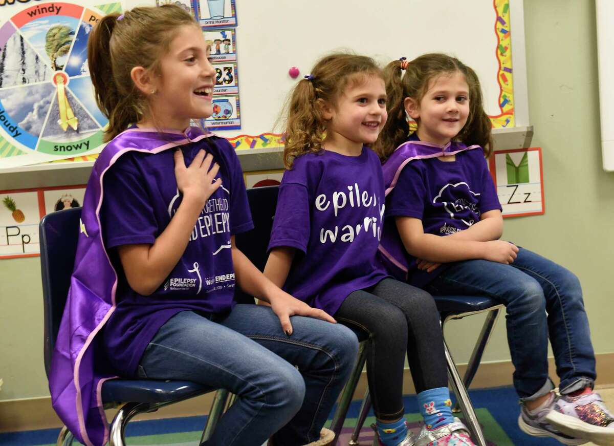 Mrs. Leigh's pre-school class listens as classmate Nova Buyce, center, and her sisters Ila, left, third grade, and Willow, first grade, explain epilepsy to them with a slide show at New Scotland Elementary School on Friday, Nov. 22, 2019 in Albany, N.Y. Nova, 4, has epilepsy. (Lori Van Buren/Times Union)