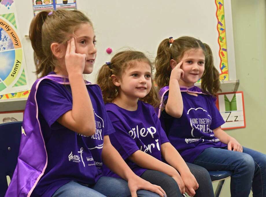 Mrs. Leigh's pre-school class listens as classmate Nova Buyce, center, and her sisters Ila, left, third grade, and Willow, first grade, explain epilepsy to them with a slide show at New Scotland Elementary School on Friday, Nov. 22, 2019 in Albany, N.Y. Nova, 4, has epilepsy. (Lori Van Buren/Times Union) Photo: Lori Van Buren, Albany Times Union / 40048321A