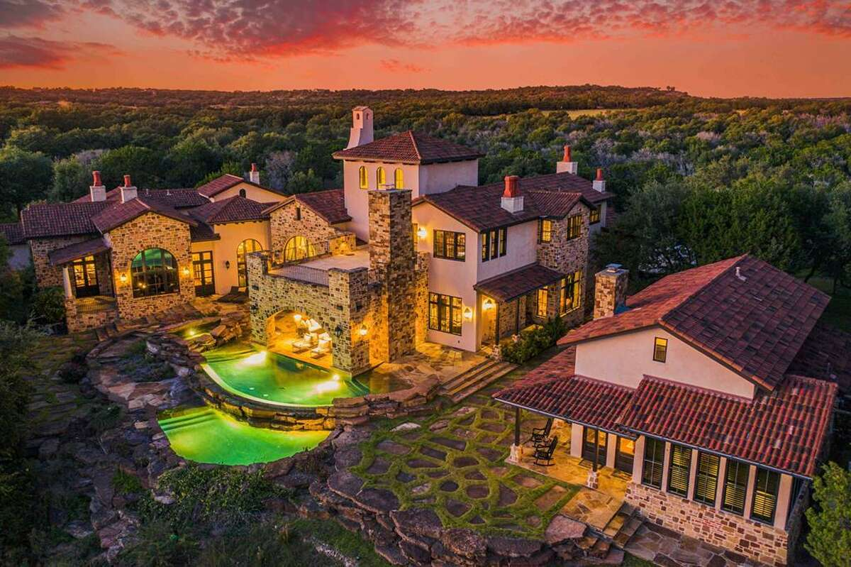 This Italian Villa-inspired ranch located six miles from Fredericksburg in the Texas Hill Country just hit the market at a whopping $13.9 million. Nestled behind 251 acres of natural scenery, the palatial estate boasts five bedrooms, five full and one half bathrooms, various outdoor patios, a detached game and media room, guest quarters, gourmet kitchen with an open fire pizza oven and infinity pool and hot tub that offers panoramic views of the serene landscape. Photo courtesy: Wingman Imagery
