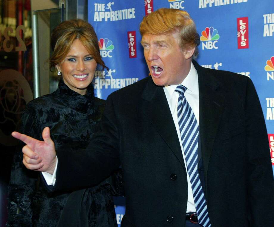 "Donald Trump and his then-fiancee, Melanie Knauss, arrive for an after-party following ""The Apprentice 2"" finale in New York on Dec. 16, 2004. When Trump announced his bid for the presidency in 2015, much of the political and media establishment thought the idea of a self-dealing, conspiracy-theorizing reality TV star winning the White House was a pretty funny joke. Few of them understood Trump's effectiveness at hacking the news landscape to command our attention completely. Photo: Jeff Christensen /Reuters / X00054"
