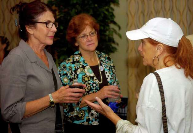 Peter Schiff's mother, Ellen Schiff, left, cousin Jane Snaider, center, and supporter Trish Summers, right, talk at the Hilton Garden Inn in Milford on Tuesday, August 10, 2010, just after polls closed. Photo: Lindsay Niegelberg / Connecticut Post