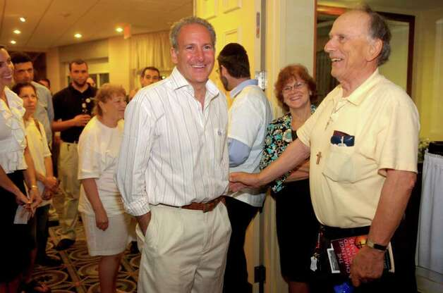Republican candidate for senate Peter Schiff, center, talks with supporter Louis Gallucci of East Haven at Hilton Garden Inn in Milford on Tuesday, August 10, 2010. Gallucci, 82, said Schiff is the first candidate he has ever worked for. Photo: Lindsay Niegelberg / Connecticut Post