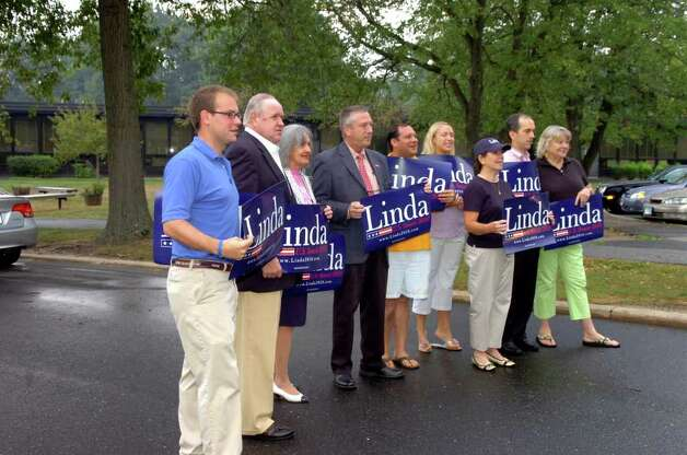 Supporters of Linda McMahon, Republican candidate for the U.S. Senate, wait for McMahon to arrive at North Street School to vote on Tuesday, Aug. 10, 2010. Photo: Helen Neafsey / Greenwich Time