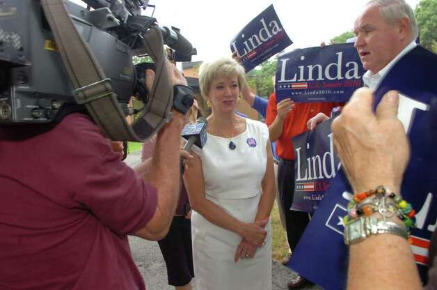 Linda McMahon, Republican candidate for the U.S. Senate, greets her supporters at North Street School where she voted on Tuesday, Aug. 10, 2010. Photo: Helen Neafsey / Greenwich Time