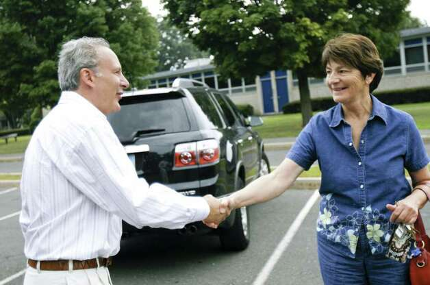 Republican senatorial candidate Peter Schiff greets Barbara Lyon outside the voting center at Sherman Elementary School in Fairfield on August 10, 2010. Schiff visited various voting centers throughout the day to talk with voters as they arrived. Photo: Laura Buckman / Connecticut Post Freelance