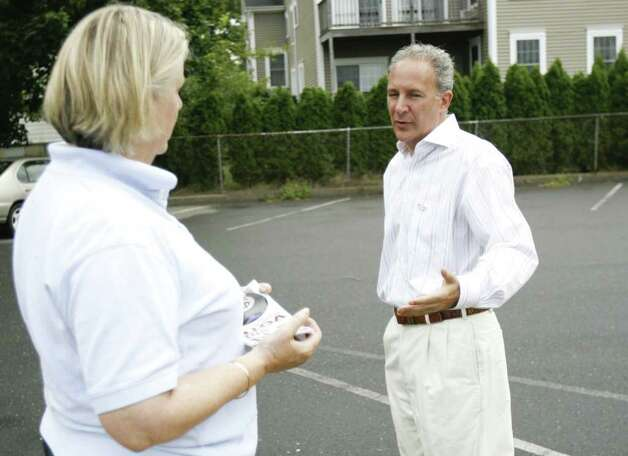 Republican senatorial candidate Peter Schiff talks with Gaylord Meyer outside the voting center at the Fairfield Senior Center on Tuesday, August 10, 2010. Schiff visited various voting centers throughout the day to talk with voters as they arrived. Photo: Laura Buckman / Connecticut Post Freelance