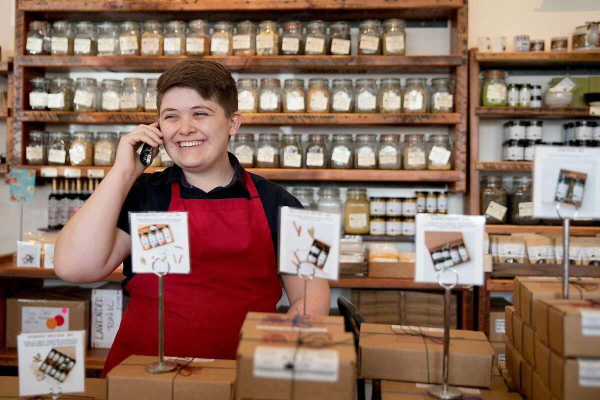 Evan Murphree Gamble chats on the phone with a customer while working at Oaktown Spice Shop in Oakland, Calif. Wednesday, Nov. 13, 2019.