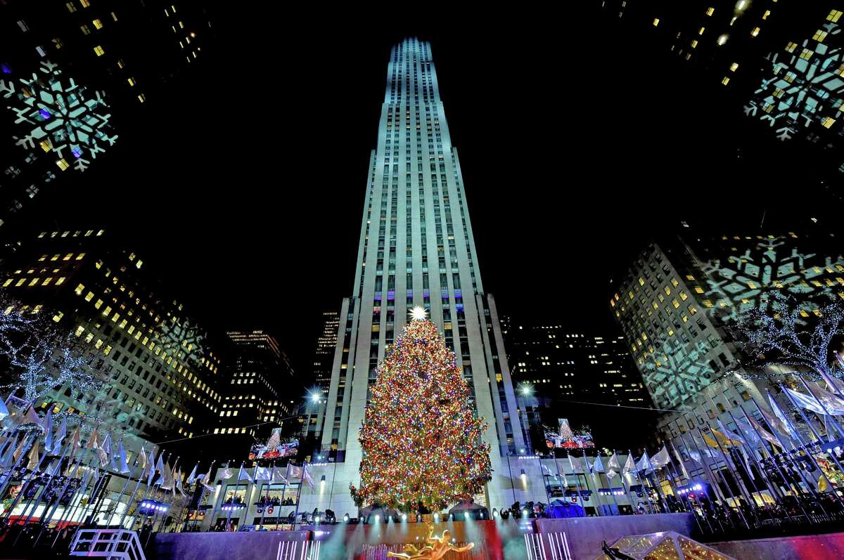 The Rockefeller Center Christmas Tree stands lit, Wednesday, Nov. 28, 2018, in New York. The 72-foot tall Norway spruce is covered with more than 50,000 multi-colored LED lights and a new Swarovski star and will remain lit until Jan. 7. (Diane Bondareff/AP Images for Tishman Speyer)