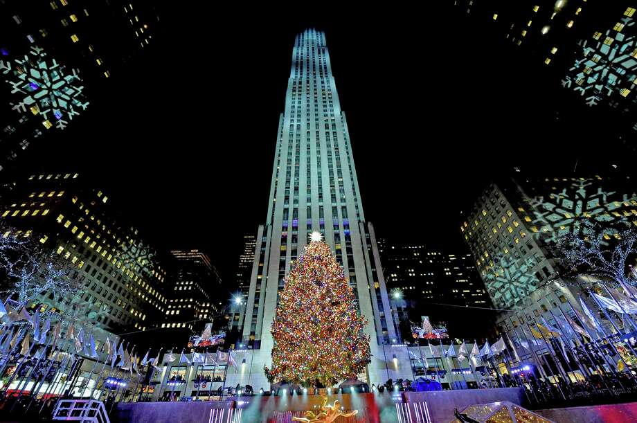 The Rockefeller Center Christmas Tree stands lit, Wednesday, Nov. 28, 2018, in New York. The 72-foot tall Norway spruce is covered with more than 50,000 multi-colored LED lights and a new Swarovski star and will remain lit until Jan. 7. (Diane Bondareff/AP Images for Tishman Speyer) Photo: Diane Bondareff / Associated Press / AP Images