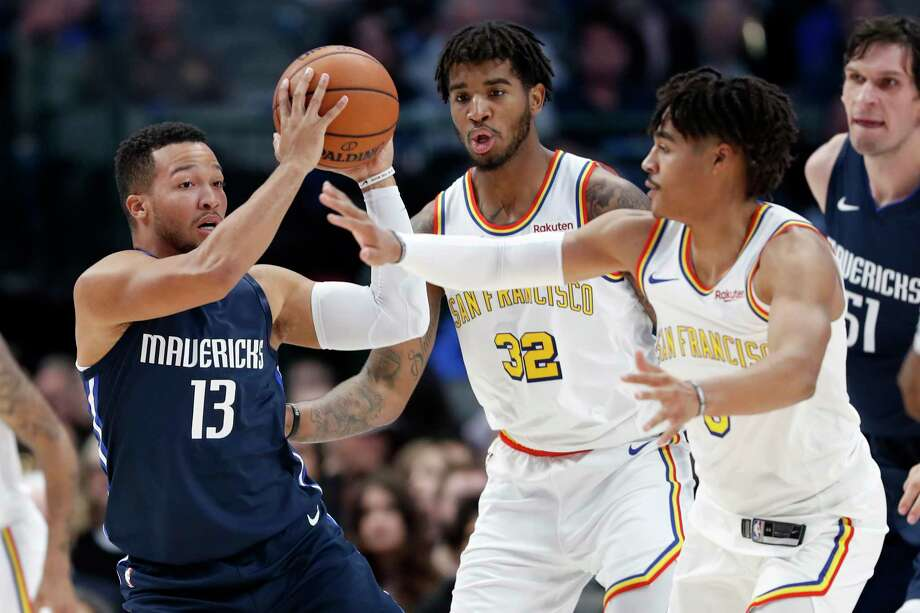 Dallas Mavericks guard Jalen Brunson (13) looks to make a pass as Golden State Warriors' Marquese Chriss (32) and Jordan Poole, right, defend in the first half of an NBA basketball game in Dallas, Wednesday, Nov. 20, 2019. Is BART's weekend service as difficult to watch as this season of the Warriors? One BART director thinks so. Photo: Tony Gutierrez, AP / Copyright 2019 The Associated Press. All rights reserved.