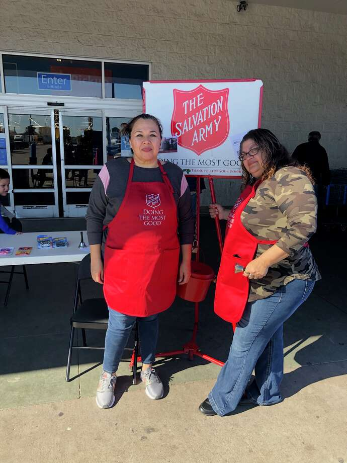 Volunteers take shifts ringing bells for the Salvation Army's Red Kettle campaign during a special campaign kickoff event in early November. Photo: Courtesy Photo/Salvation Army