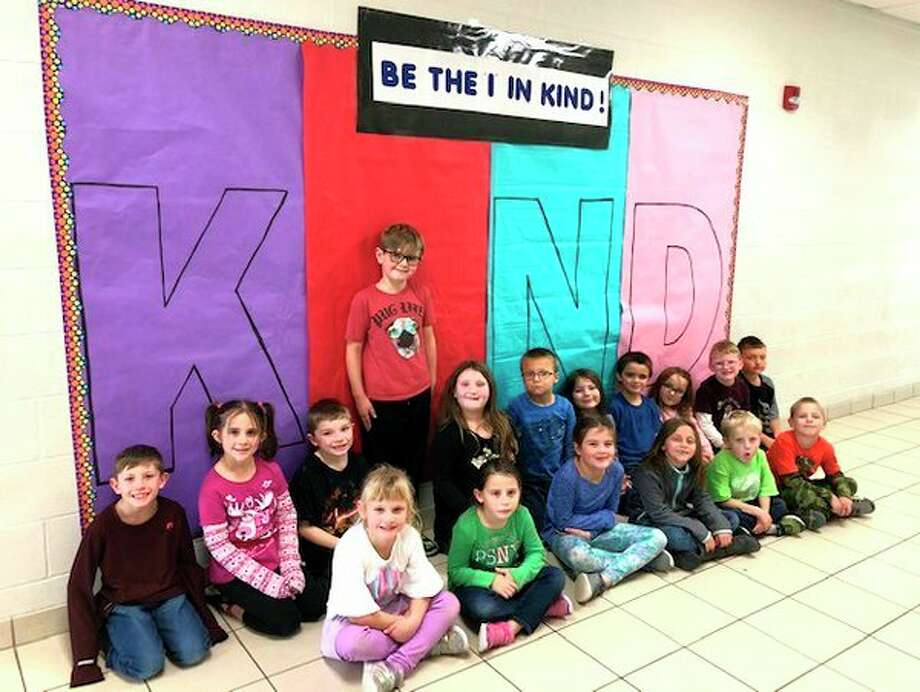 "Michelle Reibling's first grade class is pictured by a ""Put the I in Kind"" poster. (Submitted Photo)"