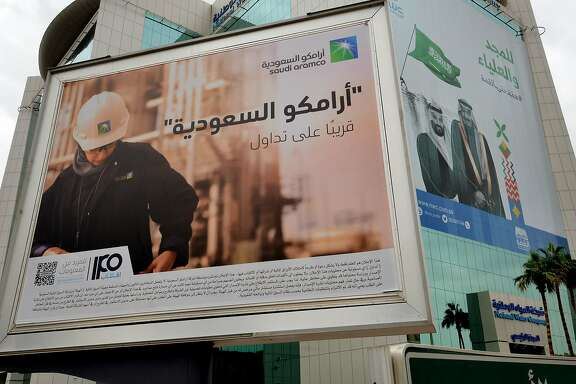 A billboard displaying an advert for Aramco is pictured in the Saudi capital Riyadh on November 18, 2019. - Saudi Arabia put a value of up to $1.71 trillion on energy giant Aramco, the day before, in what could be the world's biggest IPO, but missed Crown Prince Mohammed bin Salman's initial target of $2 trillion. (Photo by FAYEZ NURELDINE / AFP) (Photo by FAYEZ NURELDINE/AFP via Getty Images)