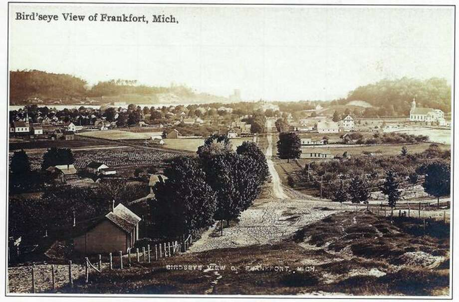 A view of Frankfort looking west from top of the hill. St. Ann church on the far right, Frankfort High School just to its left, nine story grain elevator in far distance on South Frankfort shore of Betsie Bay.(COURTESY PHOTO/Benzie Area Historical Museum and Bob McCall)