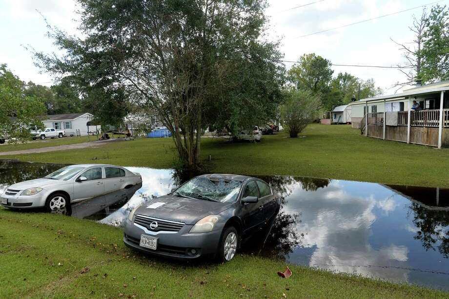 Several vehicles remain along ditches in Fannett Wednesday, including along FM 365, where they flooded out during the storm. Photo taken Wednesday, September 25, 2019 Kim Brent/The Enterprise Photo: Kim Brent / The Enterprise / BEN