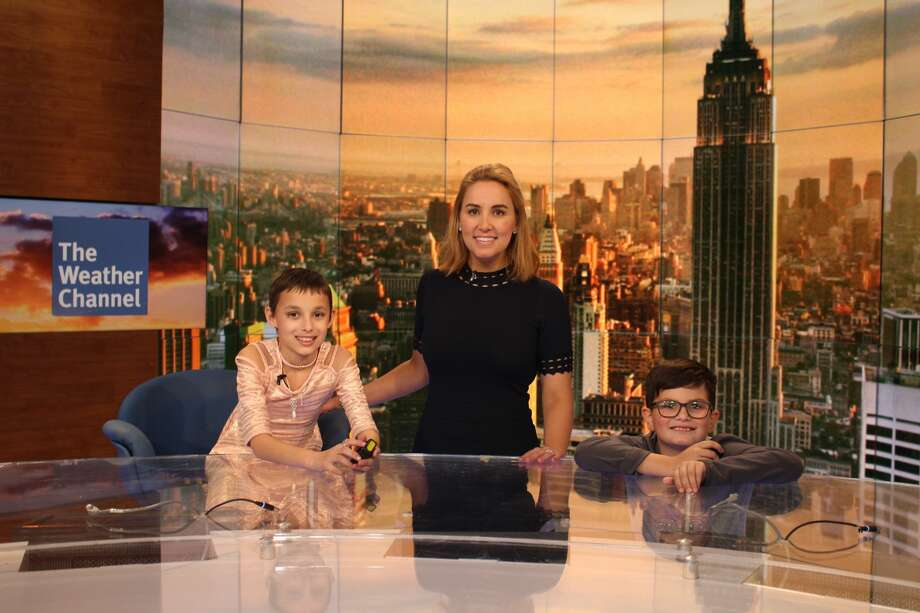 Kaylee in the newsroom with her brother and Alex Wilson. Photo: Sunshine Sachs