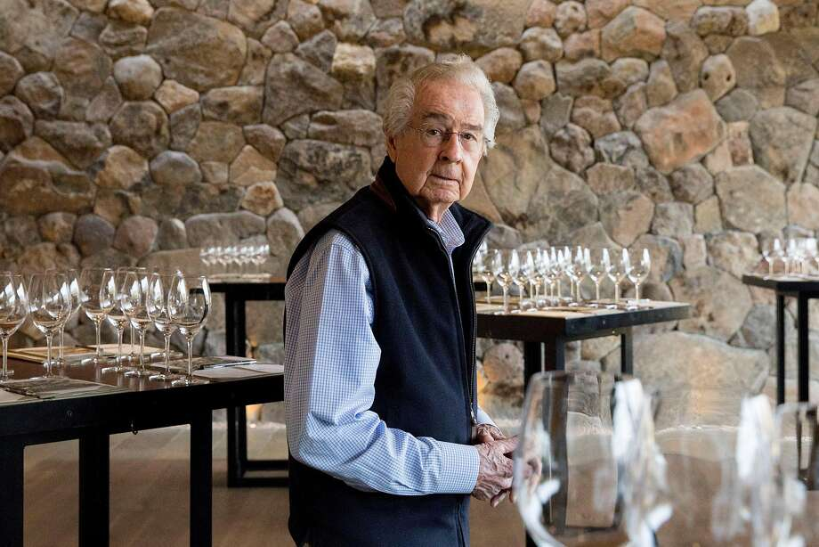 Top: World-renowned vintner and founder of Stags Leap Cellars Warren Winiarski poses for a portrait in the tasting room of Stags Leap Cellars in Napa, Calif. Tuesday, Nov. 12, 2019. Below: World-renowned vintner and founder of Stags Leap Cellars Warren Winiarski poses for a portrait near the vintage 1976 bottle of Cabernet Sauvignon which won him the Judgement of Paris competition in 1976 while inside the tasting room of Stags Leap Cellars in Napa, Calif. Tuesday, Nov. 12, 2019. Photo: Jessica Christian / The Chronicle