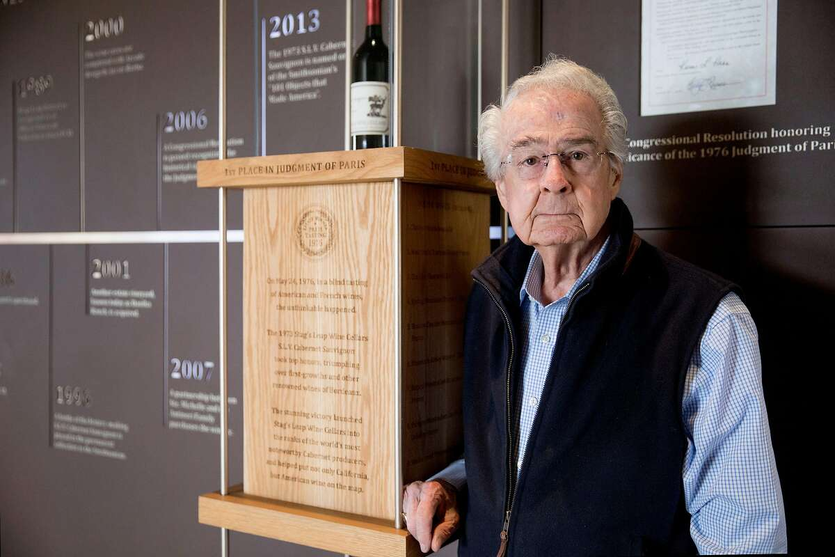 World-renowned vintner and founder of Stags Leap Cellars Warren Winiarski poses for a portrait near the vintage 1976 bottle of Cabernet Sauvignon which won him the Judgement of Paris competition in 1976 while inside the tasting room of Stags Leap Cellars in Napa, Calif. Tuesday, Nov. 12, 2019.