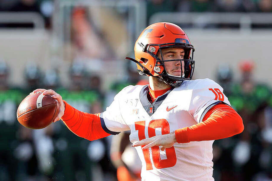 Illinois quarterback Brandon Peters throws a pass duering his team's victory at Michigan State on Nov. 9. The Illini will play Iowa Saturday. Photo: AP Photo