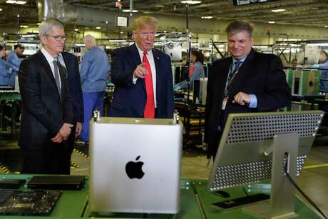 President Donald Trump tours an Apple manufacturing plant, Wednesday, Nov. 20, 2019, in Austin with Apple CEO Tim Cook, left.