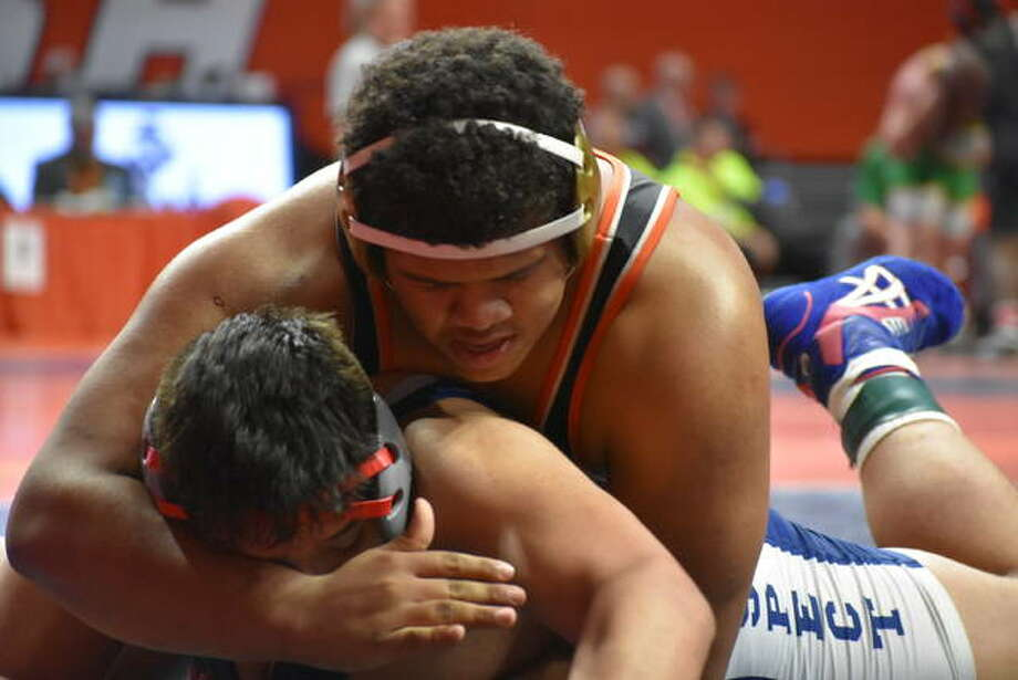 Edwardsville heavyweight Llyod Reynolds competes at the Class 3A state tournament last year at the State Farm Center in Champaign. Photo: Matt Kamp|The Intelligencer