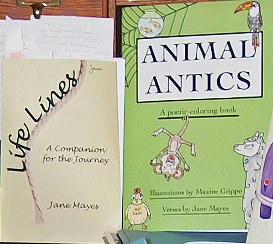 "Jane Mayes of Port Austin recently authored these two books, ""Life Lines, A Companion for the Journey,"" and ""Animal Antics, a Poetic Coloring Book."" (Bill Diller/For the Tribune)"