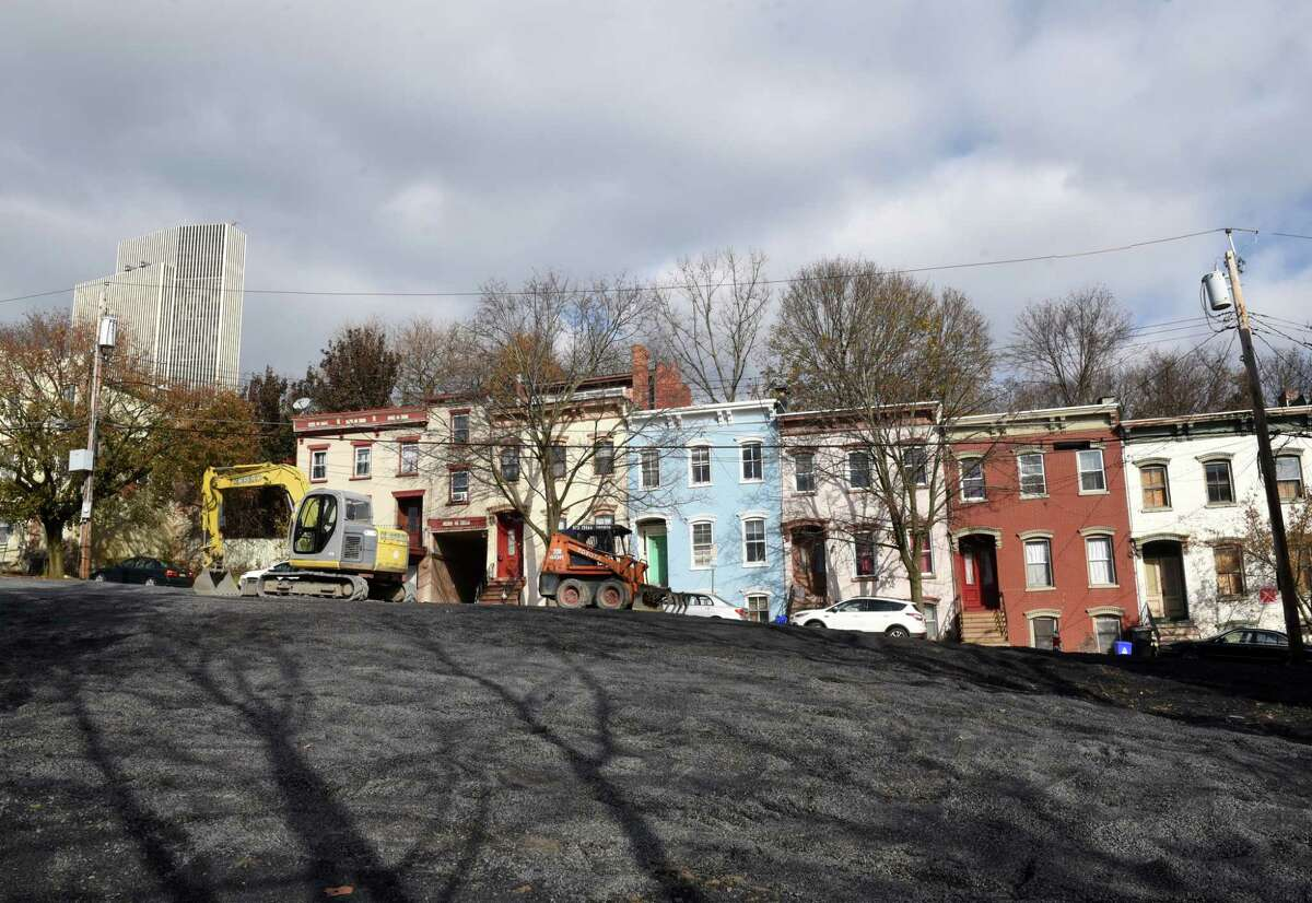 An empty lot now stands on Myrtle Avenue where five buildings were demolished following an August fire on Thursday, Nov. 21, 2019, in Albany, N.Y. (Will Waldron/Times Union)
