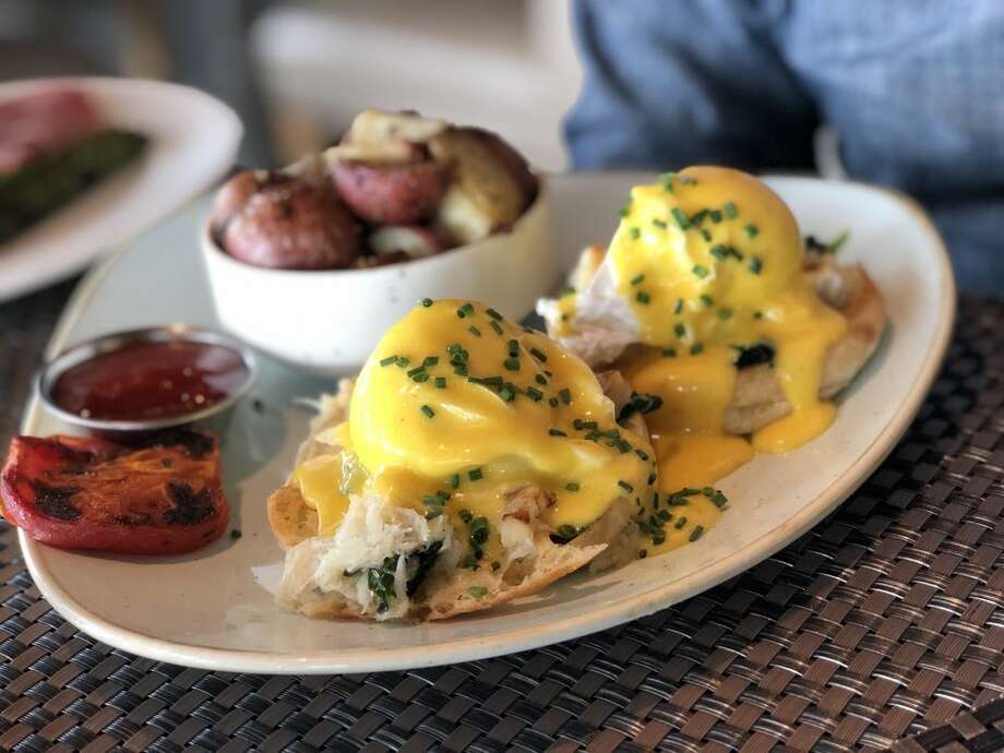 Six Seven dishes out a Dungeness Crab Benedict. Keep clicking for Seattle's other top PNW-inspired brunch plates. Photo: Ann S/Yelp