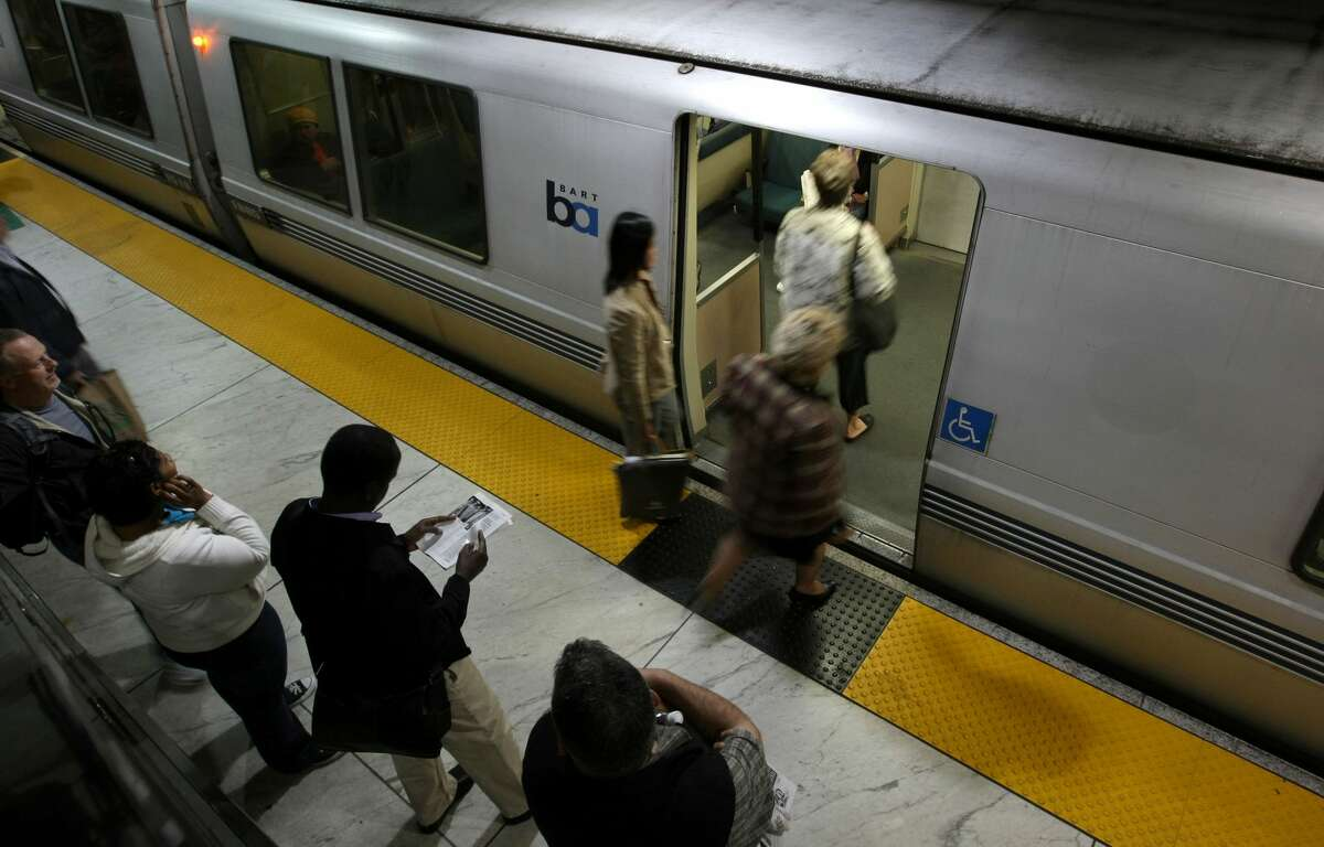 FILE - Bay Area Rapid Transit (BART) passengers board a train at the Powell Street station in San Francisco, California. Less people are riding BART at night and on weekends, according to new figures reported by the Chronicle, citing lessened service and issues around safety.
