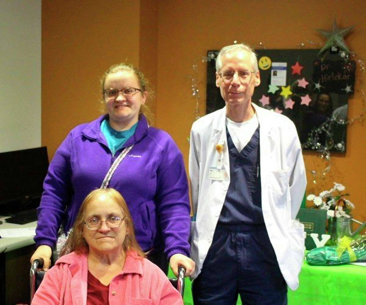 Mat Wellnitz was nominated for Spectrum Health's DAISY Award by Darla Clark, seated, for the care he gave her husband. Their daughter, Baylee Clark, is at left. (Courtesy photo)