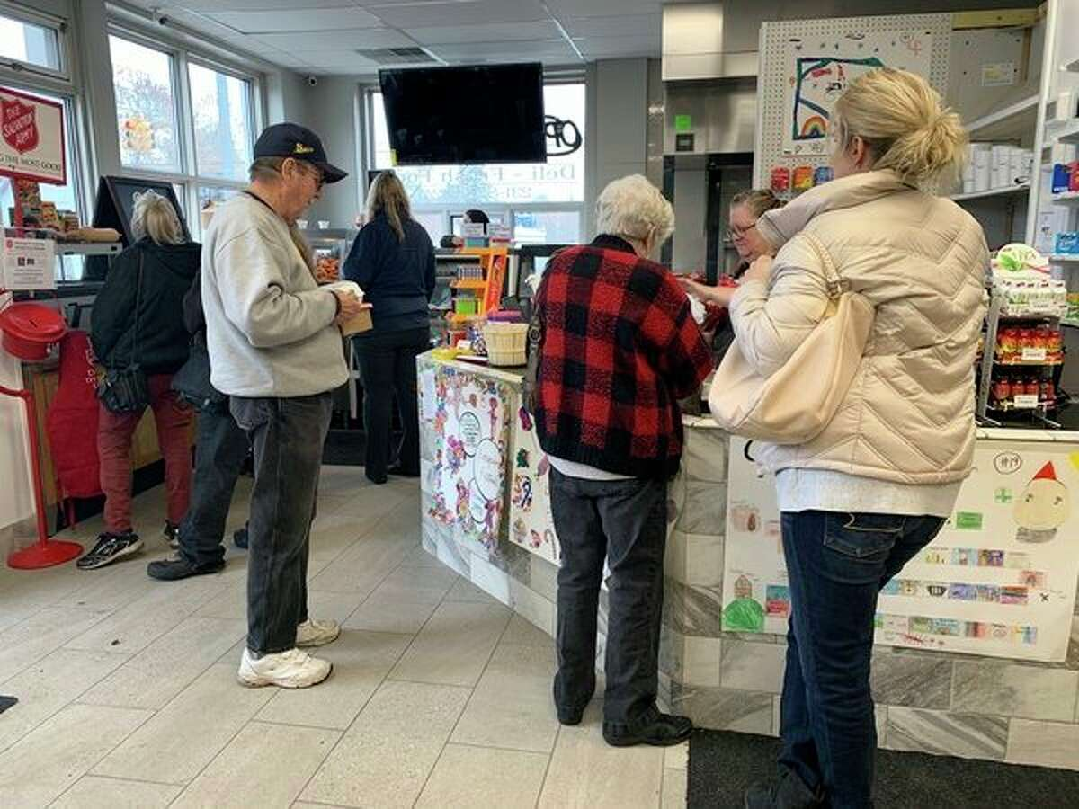 Shopper take advantage of the new J and A Grocery store in Reed City to pick up a quick lunch or a few essentials. J and A opened earlier this month at 702 S. Chestnut. (Herald Review photo/Cathie Crew)
