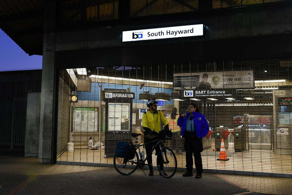 Mike Stroud, talks to a BART Policer about alternative methods to complete his commute after BART Police shut down the South Hayward BART Station because of a homicide on one of the transit system�s trains on November 20, 2019 in Hayward, Calif.